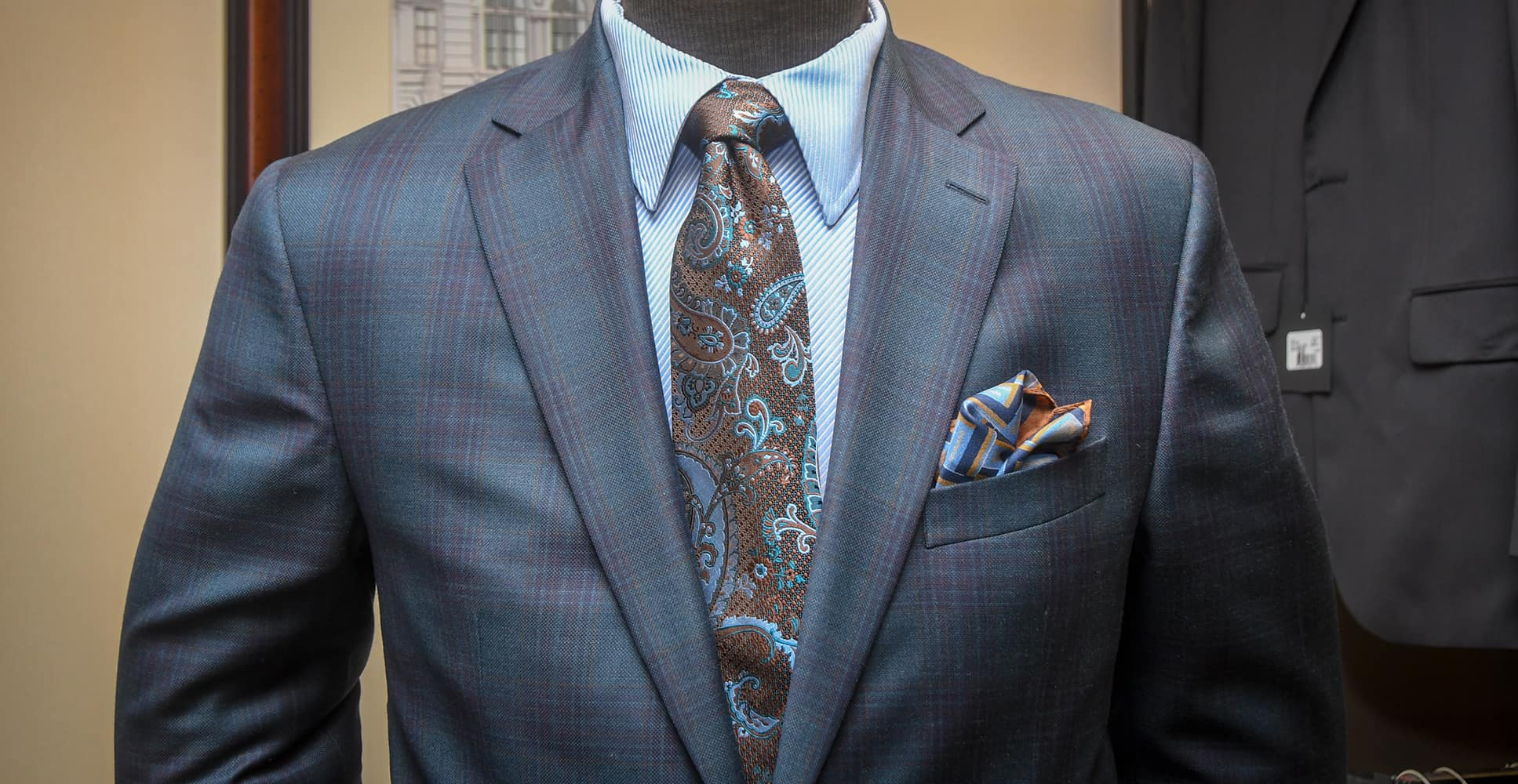 A suit and tie with a pocket square